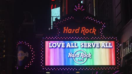 kereszt : Hard Rock Cafe Sign Celebrating Homosexuality With Gay Flag Colors - Static