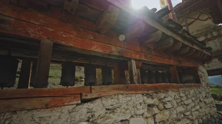 stoned : Old stoned and wooden Mani wall with bouddhist prayer wheels in highlands, Nepal