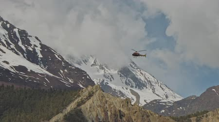 hegytömb : Helicopter fly above mountain valley, snow Annapurna massif with clouds, Nepal