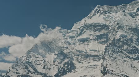 csúcs : Terrific view, harsh face of snowy colossal mountain Annapurna II with clouds