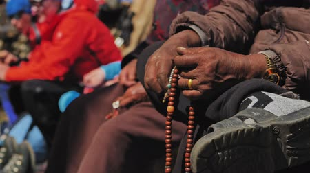 mala : Hands of aged nepali man hold prayer mala, counting beads at meditation, Nepal