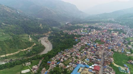 nepal : Panorama of misty provincial town beside mountain river valley Stock Footage
