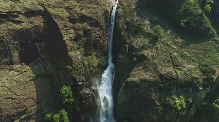 nepal : Aerial wide angle view on a waterfall falling to a deep river gorge