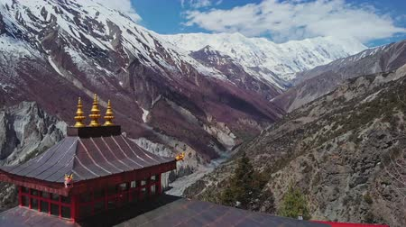 nepal : Incredible panorama, red pagoda at highlands, snow Tilicho Peak at horizon,Nepal Stock Footage