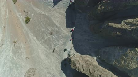 conquest : Overhead view, tourist trekking expedition, narrow path over scree slope, Nepal