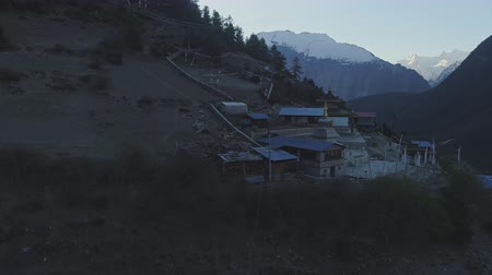 nepal : Misty twilight panorama, lost mountain village, dark snowy Paungda Danga ridge Stock Footage