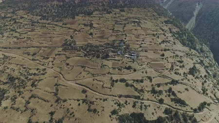 nepal : Aerial panning beside highland slope, small Ghyaru village, rural empty fileds