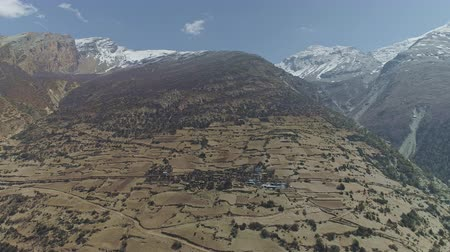 nepal : Birds eyes view, secluded Ghyaru village on spacious slope near snow Pisang Peak