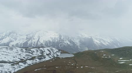 плато : Birds eye view, highland lake on plateau, snowy Annapurna hidden in strong cloud