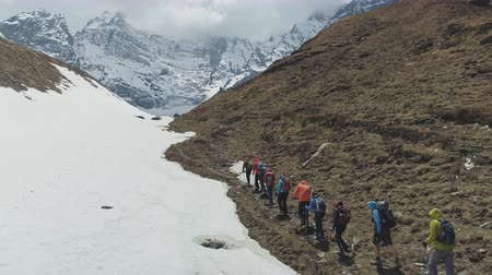 conquest : Tourists trekking, expedition to snowy mountain foot of Annapurna III, Nepal
