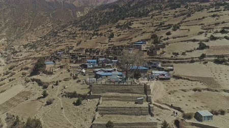 elvonult : Aerial panorama around lovely secluded Ghyaru village, terraces, stupa,viewpoint