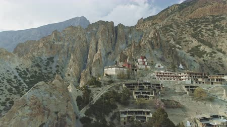 elvonult : Aerial panoramia over sharp crest cliffs with solituded Braga monastery, Nepal