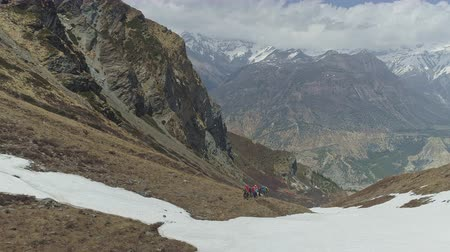 conquest : Tourists trekking, expedition over snow slope, severe highland scenery, Nepal