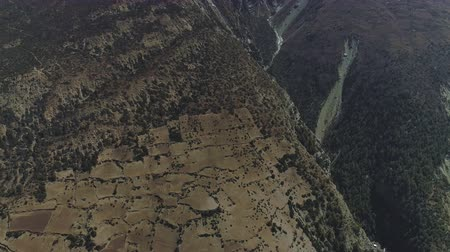 elvonult : Stunning high overhead view on mountain slope with secluded Ghyaru village,Nepal