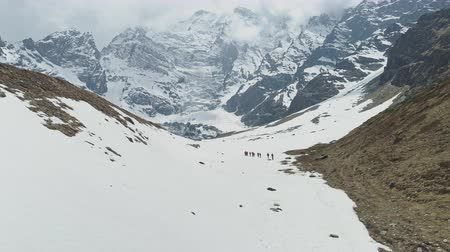 conquest : Tourists trekking to snow foots of majestic mountain, highland expedition, Nepal