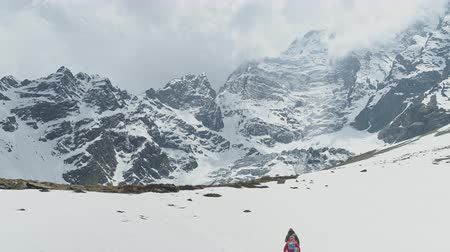 conquest : Trekking tourists, highland expedition to foots snowy Annapurna III Mount, Nepal