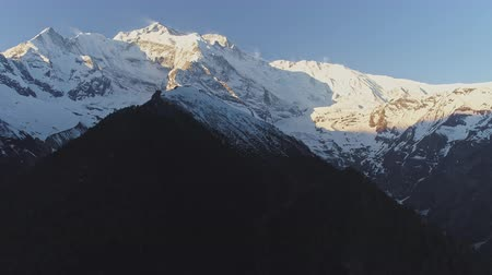 elvonult : Incredible panorama, glow snowy Annapurna II mountain towering on dark slopes