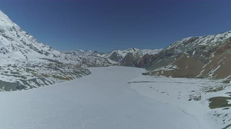 greatness : Flying above highland fully frozen ice, snow white surface of Tilicho Lake,Nepal