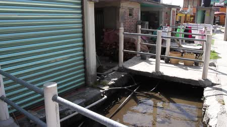 komar : Open sewer system in a poor neighborhood near Mexico City Outskirts CA 2014 Wideo