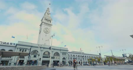 Ferry Building in San Francisco, crowds of people and commuters walking and enjoying the square