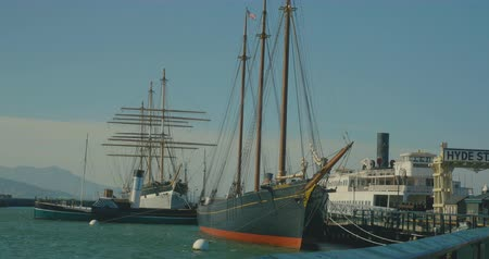 Old bighistorical  sail ships are sitting by the pier in San Francisco Wideo