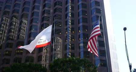 California Republic and United States Flags are waving with the wind in San Francisco Finnancial building