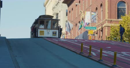 Cable Car riding in California Street, historical mass transportation system in the hills of San Francisco