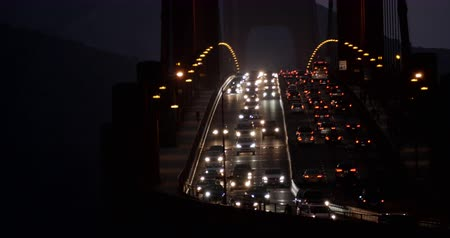 san francisco : Traffic on rush hour at the Golden Gate Bridge in San Francisco by night wide shot