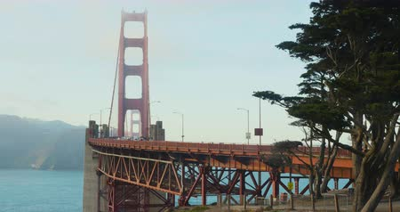 Golden Gate Bridge road with cars, bikes and people passing by in a bussy rush hour day