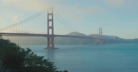 Golden Gate Bridge look from one side clouds and sunset foggy Wideo