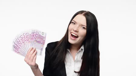 izgatott : Happy excited business woman showing fan of euro cash money celebrating success and showing thumb up gesture