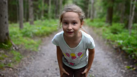 sen : Little girl child in summer forest running to the camera, stopping talking to you and showing welcoming gesture inviting to run together