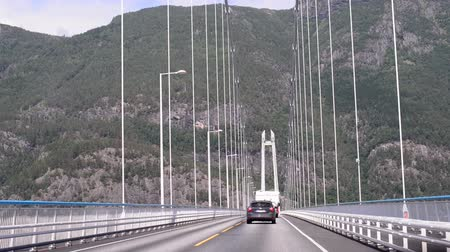 İskandinavya : Driving shot on suspension bridge in Norway Stok Video