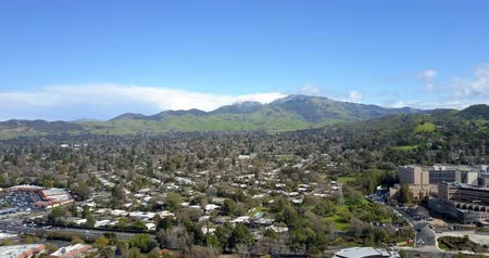 diablo : Flying over areal view of Walnut Creek with peaks of Mount Diablo covered with spring snow at background Stock Footage
