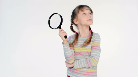 detectives : Little girl standing with magnifying glass, locked down real time video