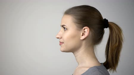 kulaklar : Closeup profile of confident woman looking at copy space in front of she upwards isolated on gray background