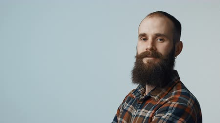 серьги : Closeup of confident bearded man standing looking at camera, portrait with copy space Стоковые видеозаписи