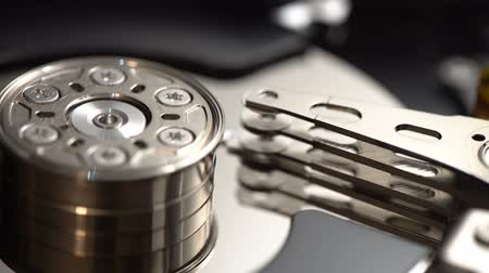 архив : Closeup internals of SATA hard disk drive, shallow depth of field, sliding video