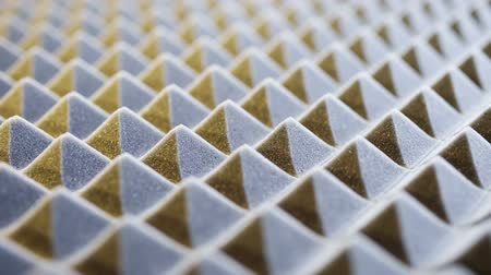 абсорбент : Macro of acoustic foam panel background, sliding video, shallow depth of field