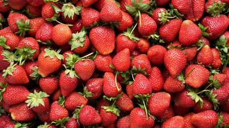Background top view 4k video of strawberries rotating