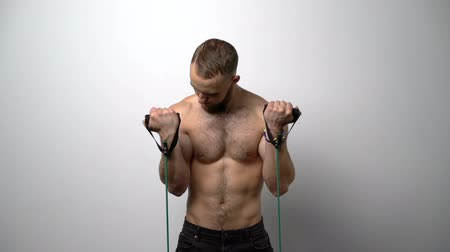 üstsüz : Slow motion video of a shirtless muscular man training with Resistance Band