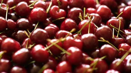 Background 4k video of ripe cherries rotating