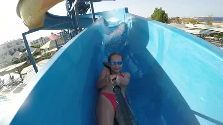 waterslide : Slow motion video of a happy girl on waterslide in aqua park pipe