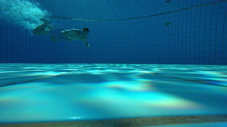 The underwater view of an empty swimming pool