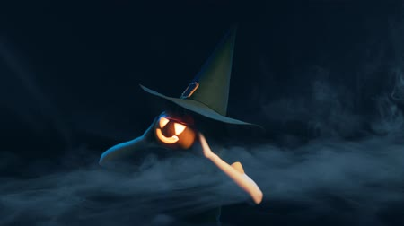 tykev : Happy playful child girl wearing black witch hat holding jack-o-lantern in front of face dancing then lowering pumking smiling at camera, over black background with smoke