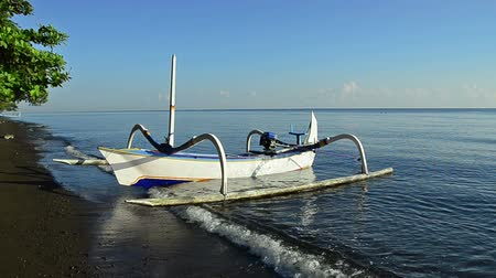 fishermen : boat of a fisherman in Bali called Jukung Stock Footage
