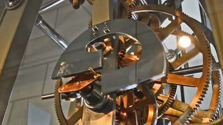 заводной : clockwork of an old tower clock with huge gears. Located in Dresden.