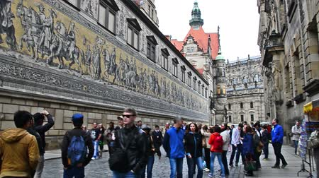 oper : Dresden, Germany - April, 25. 2014: procession of the nobility and princes of Saxony, painted on wall - the Furstenzug. Famous painting on  porcelain mosaics. 102m long.
