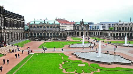 saray : Dresden, Germany - April, 25. 2014: Dresden Zwinger - the famous historic building in the city in Germany. People walking around. Stok Video