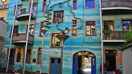více barevné : Dresden, Germany - April, 25. 2014 - Kunsthofpassage in Dresden, Germany. This area with old buildings was an project of some artists making the  facades of the buildings more colorful. And if it rains, it makes music.